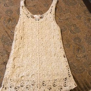 Cream colored crocheted tunic length top